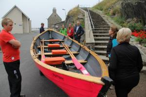 Taking the skiff to the harbour...